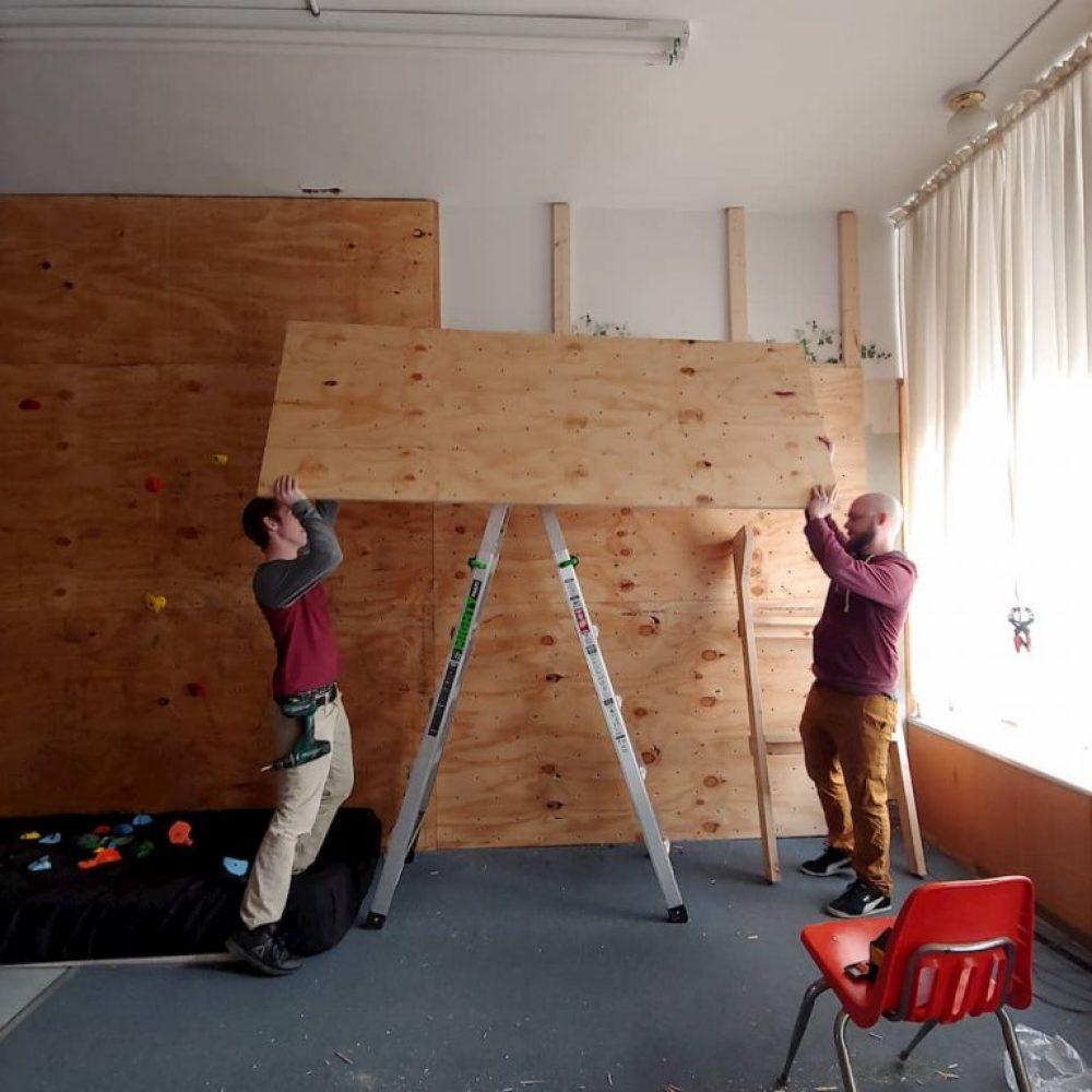 Alexander and Josiah placing a panel